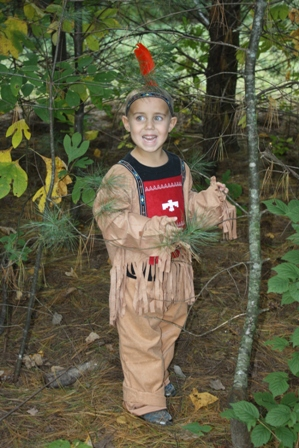 Indian costume on a boy in the woods
